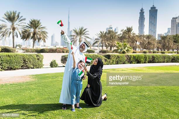 happy emirate family celebrate the national day