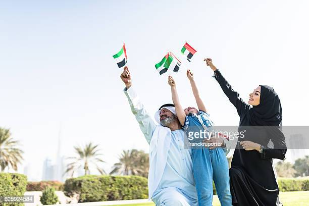 happy emirate family celebrate the national day - uae national day stock photos and pictures