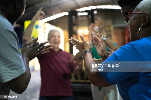 happy employees celebrating together at warehouse - admiration stock pictures, royalty-free photos & images