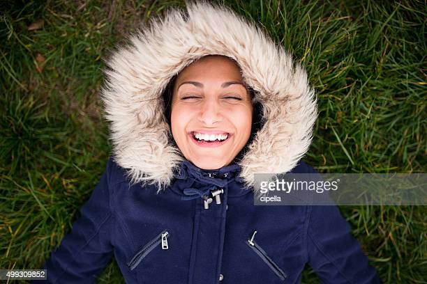 happy eskimo girl on the ground,laughing - fur jacket stock pictures, royalty-free photos & images