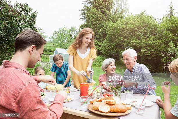 Happy extended family dining in garden
