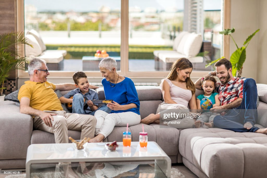 Happy extended family enjoying in their free time at home. : Stock Photo