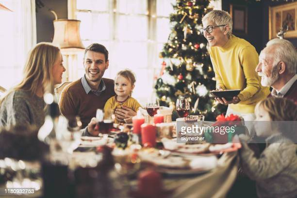 happy extended family having lunch on new year's day at home. - dia de ano novo imagens e fotografias de stock