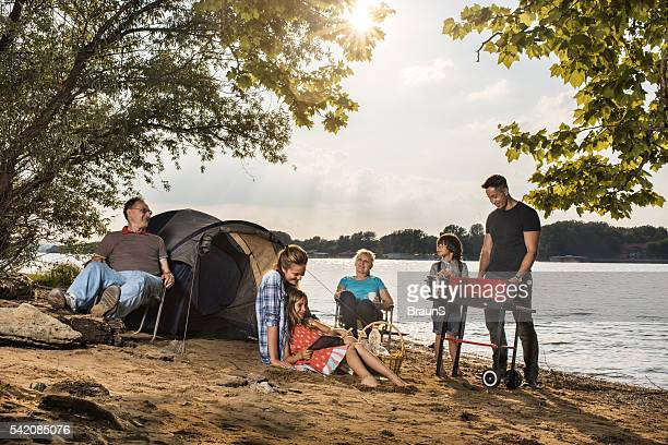 Happy extended family spending a day on camping.