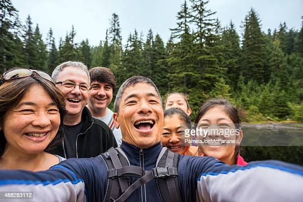 Happy, Extended Multi-Ethnic Family Taking Selfie While Hiking in Woods