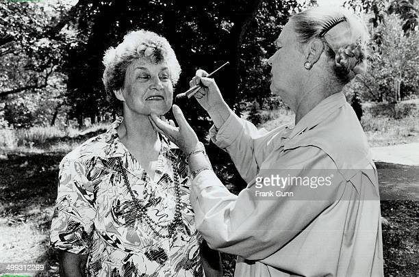 Happy face Ann Campbell right a professional makeup artists shows Margaret Judge a few tricks of the trade in preparation for High Park senior's...
