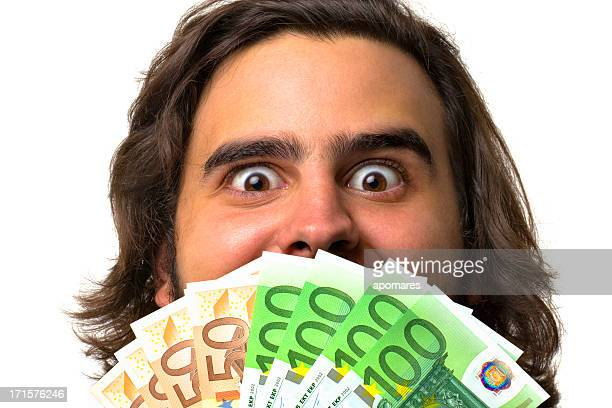 Glückliches Gesicht junger Mann mit Geld in der hand.