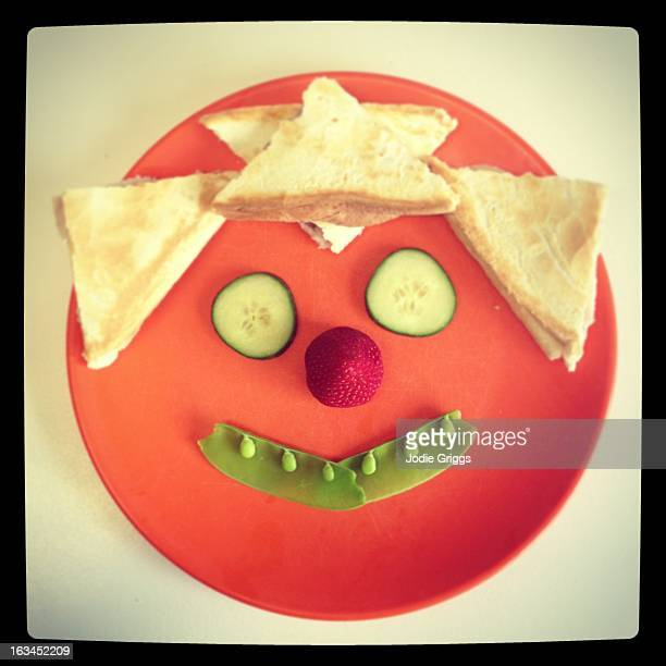 Happy face on a plate made from healthy food