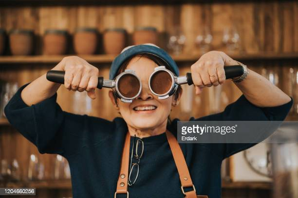 happy face with active senior women barista and her working tool - funny customer service stock pictures, royalty-free photos & images