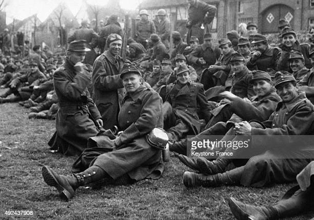 Happy faces of soldiers of the Hungarian army captured by US forces and soon returning to their country on April 5 1945 in Geseke Germany