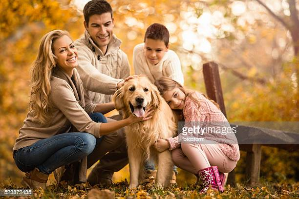 Happy Family And Dog In Autumn