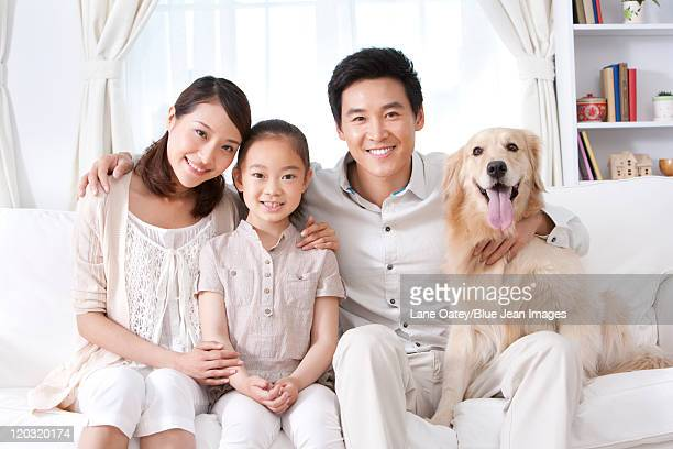 Happy Family and Dog on Sofa