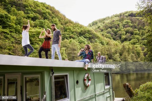 happy family and friends having fun on a houseboat - houseboat stock pictures, royalty-free photos & images