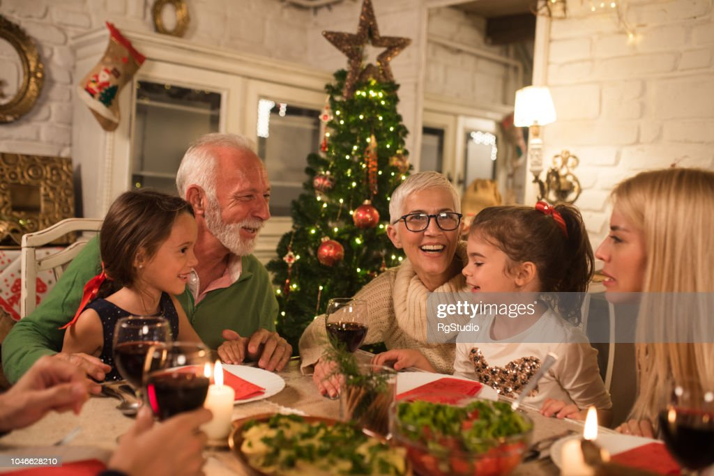 Christmas Dinner Party.Happy Family At Christmas Dinner Party High Res Stock Photo
