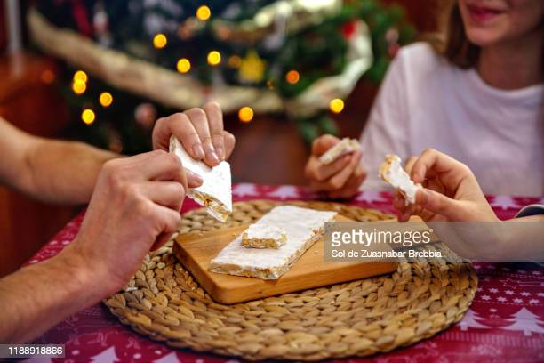 happy family at christmas time - nougat stock pictures, royalty-free photos & images