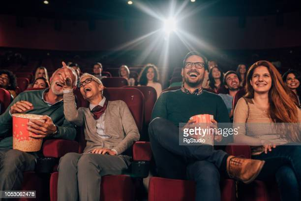 happy family at cinema - film premiere stock pictures, royalty-free photos & images