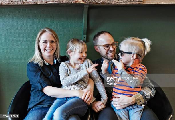 Happy family at eyeglasses workshop