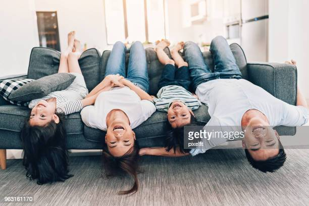 happy family at home concept - upside down stock pictures, royalty-free photos & images