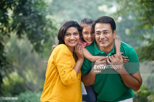happy family at park - indian ethnicity stock pictures, royalty-free photos & images