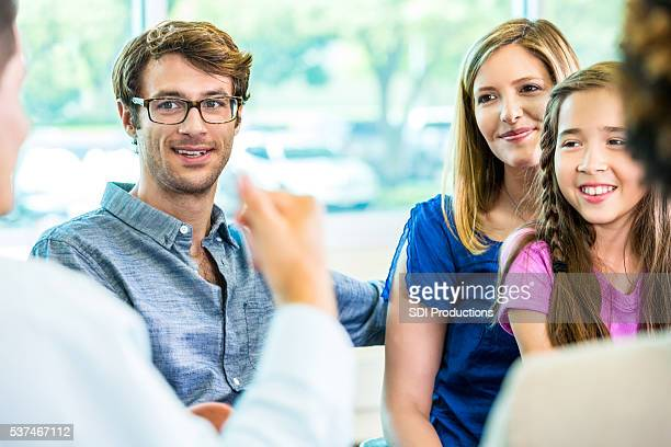 Happy family at student teacher meeting
