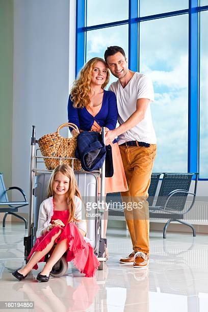happy family at the airport - izusek stock pictures, royalty-free photos & images