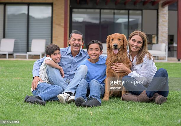 Happy family at the countryside house with a dog