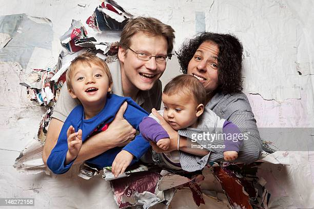 Happy family busting through a wall