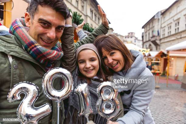 Happy family celebrate New Year's Eve