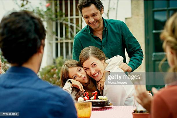happy family celebrating birthday in yard - life events stock pictures, royalty-free photos & images