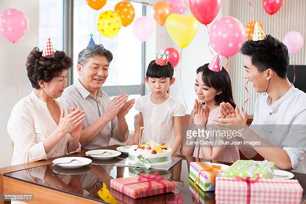Happy family celebrating birthday