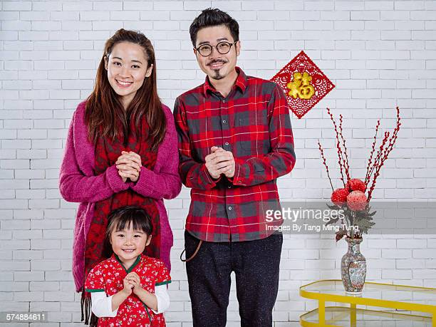 Happy family celebrating Chinese New Year at home