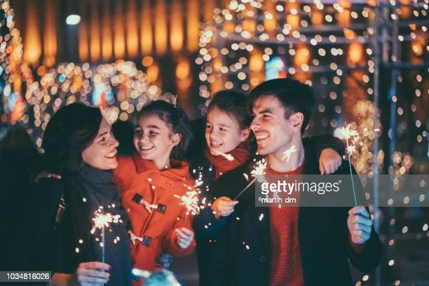 happy family celebrating christmas and new year together - new year's eve stock pictures, royalty-free photos & images
