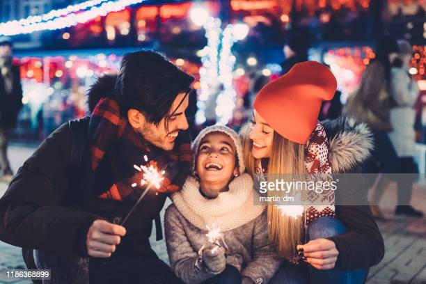 happy family celebrating christmas - christmas family stock pictures, royalty-free photos & images
