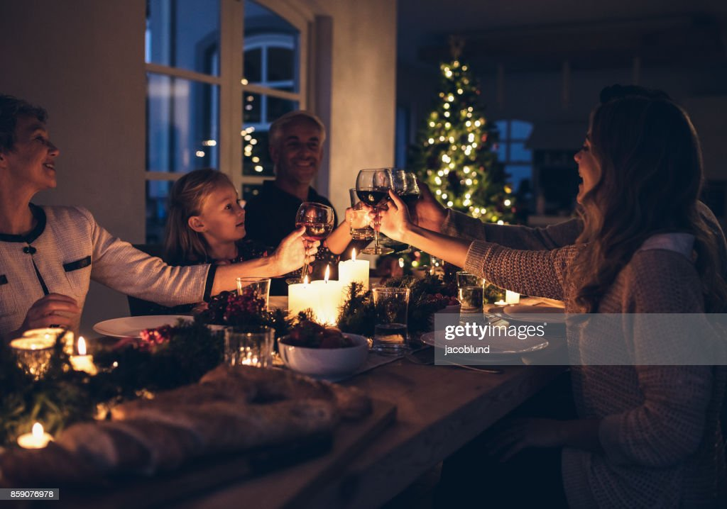 Happy family celebrating christmas together at home : Stock Photo