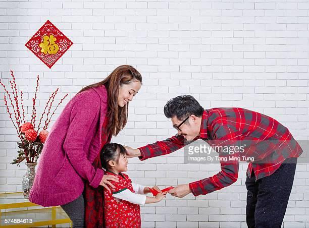 Happy family celebrating CNY joyfully at home