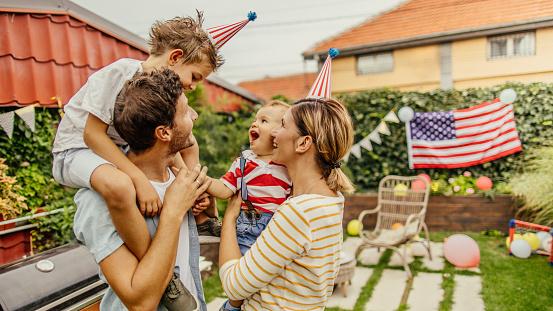Happy family celebrating Fourth of July 1199700737