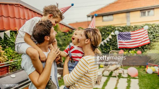 happy family celebrating fourth of july - independence day stock pictures, royalty-free photos & images