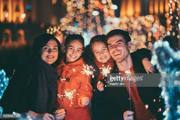 happy family celebrating new year - fete stock photos and pictures