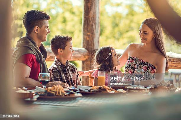 Happy family communicating in a restaurant.