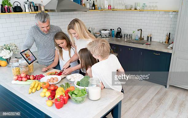 Happy family cooking at home