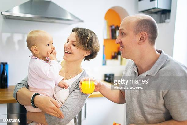 Happy family cooking breakfast together