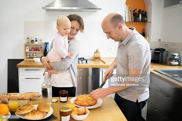 Happy family cooking french breakfast together