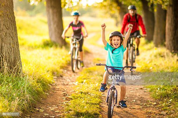 happy family cycling in the countryside - sports race stock pictures, royalty-free photos & images