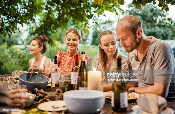 Happy Family Dinner In The Garden