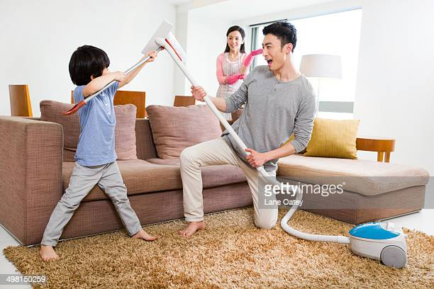Happy family doing chores at home