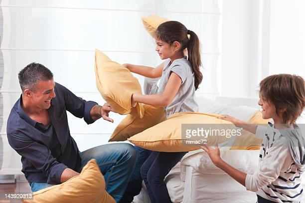 Happy Family Doing Pillow Fight