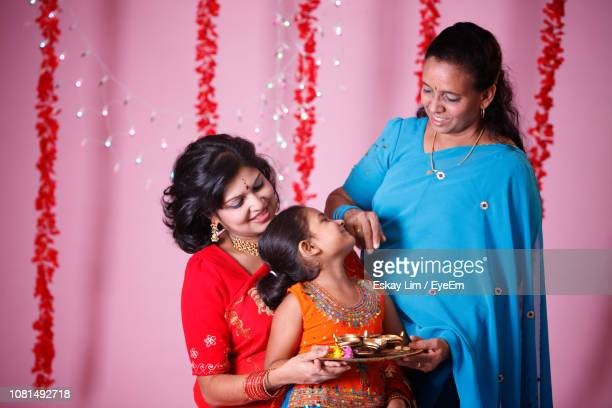 happy family during diwali - diwali celebration stock photos and pictures
