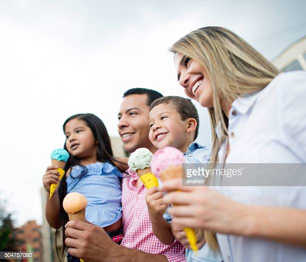 Happy family eating ice creams