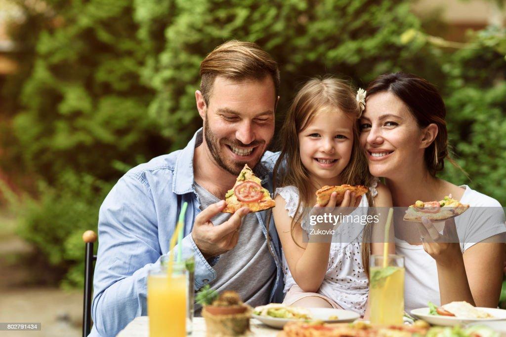 Happy Family eating outdoors : Stock Photo