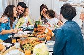Happy family eating roasted turkey
